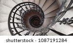 a spiral staircase spiraling... | Shutterstock . vector #1087191284