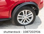 flat tire from car accident. | Shutterstock . vector #1087202936