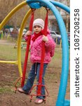 Small photo of Moscow, Russia, 24/25/2007: the child swings on a broken swing