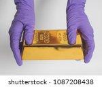 Woman's Hand In Purple Gloves...