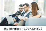 employees with a laptop... | Shutterstock . vector #1087224626