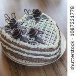 homemade dark sponge cake with...   Shutterstock . vector #1087231778