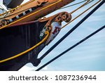Small photo of Close-up wooden forepart of a sail ship with the coloured beautiful decoration against the blue sky