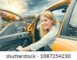 beautiful blonde girl driving a ... | Shutterstock . vector #1087254230