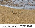 Heart Drawn On Wet Sand Beach....
