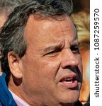 Small photo of Kansas CIty, USA, October 31, 2014 New Jersey Governor Chris Christy surrounded by Republicans at a campaign bus tour stop rally outside the Kansas City Motor Speedway to support Senator Pat Roberts