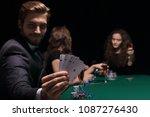 gambler man in casino sitting...