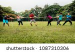 team competing in tug of war | Shutterstock . vector #1087310306