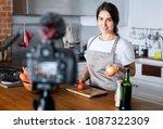 female vlogger recording... | Shutterstock . vector #1087322309
