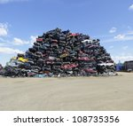 Piled Up Compressed Cars Going...