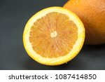 orange  juicy half of orange on ... | Shutterstock . vector #1087414850