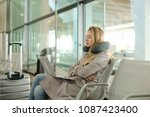pretty woman sitting in waiting ... | Shutterstock . vector #1087423400