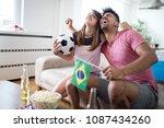 young couple sport fans... | Shutterstock . vector #1087434260