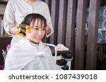 a woman wearing a perm | Shutterstock . vector #1087439018