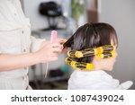 a woman wearing a perm | Shutterstock . vector #1087439024