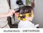 a woman wearing a perm | Shutterstock . vector #1087439030