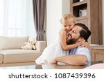hugging happy father and his... | Shutterstock . vector #1087439396