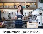 asian women barista smiling  in ... | Shutterstock . vector #1087441823