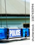 police vehicle sign with blue... | Shutterstock . vector #1087450994