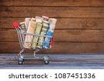 shopping cart with money... | Shutterstock . vector #1087451336