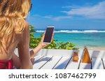girl using cellphone in the... | Shutterstock . vector #1087462799