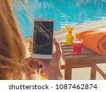 girl using cellphone near the... | Shutterstock . vector #1087462874