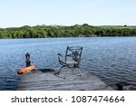 lake side with fishing bridge... | Shutterstock . vector #1087474664