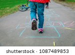 Little Girl Play Hopscotch On...