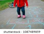 Little Girl Play Hopscotch On...
