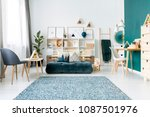 patterned carpet near armchair... | Shutterstock . vector #1087501976