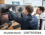 businessmen trading stocks... | Shutterstock . vector #1087505066