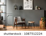grey armchair next to a wooden... | Shutterstock . vector #1087512224