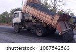 asphalt road is rebuilding. | Shutterstock . vector #1087542563