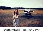 girl posing near aircraft ... | Shutterstock . vector #1087549190