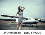 girl posing near aircraft ... | Shutterstock . vector #1087549208
