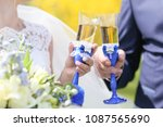 hands of newlyweds holding... | Shutterstock . vector #1087565690