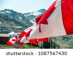 canada flags waving at the wind ... | Shutterstock . vector #1087567430