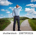 man standing at fork of road... | Shutterstock . vector #1087593326