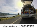 a camper van with its trunk... | Shutterstock . vector #1087597970