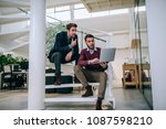 two businessman sitting on the... | Shutterstock . vector #1087598210