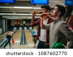 two guys drinking beer in a...   Shutterstock . vector #1087602770
