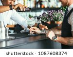 detail of the hands of a mixed... | Shutterstock . vector #1087608374