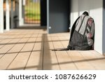 solitary lone grey backpack... | Shutterstock . vector #1087626629