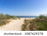 sandy path to the beach between ... | Shutterstock . vector #1087629278