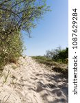 sandy path to the beach between ... | Shutterstock . vector #1087629284
