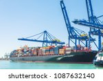 container ship in harbor | Shutterstock . vector #1087632140