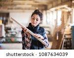 portrait of a woman worker in... | Shutterstock . vector #1087634039