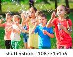 group of children blowing soap... | Shutterstock . vector #1087715456