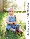 cute little girl and cherry... | Shutterstock . vector #1087735406