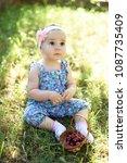 cute little girl and cherry... | Shutterstock . vector #1087735409